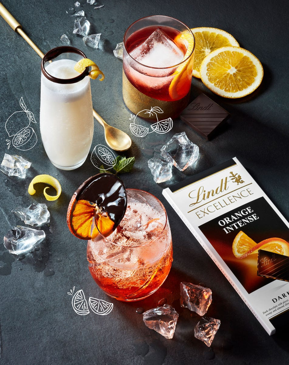 Lindt Excellence chocolate bar pictured with 3 different cocktails.